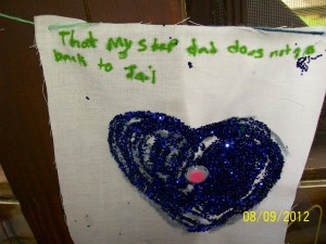 "Camper's art project says, ""That my step dad does not go back to Jail"""