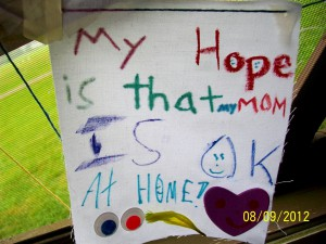 "Camper's art project says, ""My Hope is that MY MOM IS OK AT HOME!"""